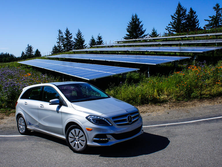 2014 Mercedes B-Class Electric Drive parked by solar panels