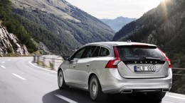 Rear view of Volvo V60 plug-in hybrid vehicle with integrated tail pipes
